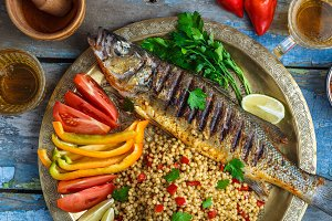 Close view of grilled sea bass with