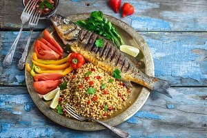 Grilled sea bass on coper plate