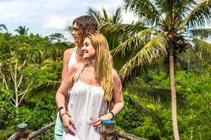 Young honeymoon couple posing on the
