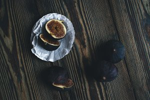 Fresh ripe figs on wooden background