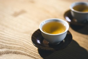 Two cups of freshly brewed green tea
