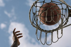 Hand Reaching To Score At Basketball