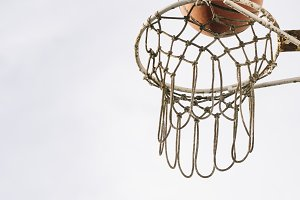 Ball In The Basket During A Basketba