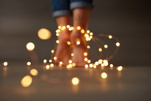 Christmas composition of female feet