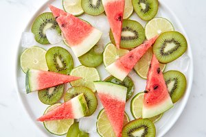 Plate with pieces of fresh kiwi