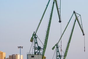 Two heavy cranes for loading