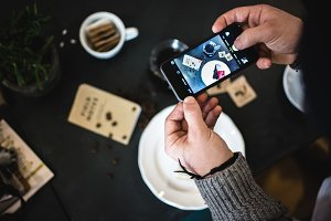 Man taking picture of coffee