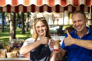Man and woman barista with a glass o