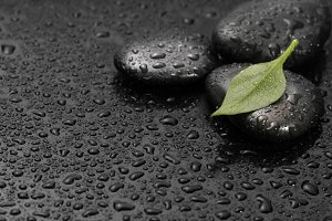 black stones and leaf with drops