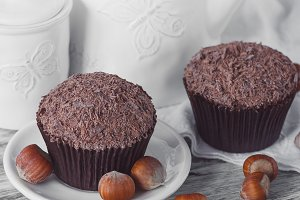 Teapot, chocolate cupcakes, nuts and