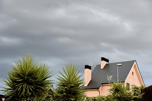 cloudy sky and landscape with house
