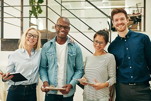 Diverse businesspeople laughing whil