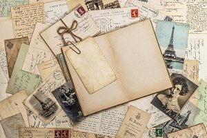 Open book, old letters and postcards