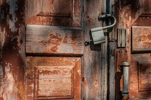 old door and rusty padlock