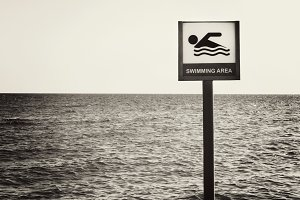 sign can float on the sea beach in b