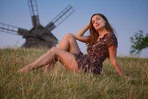 Girl and windmill at sunset
