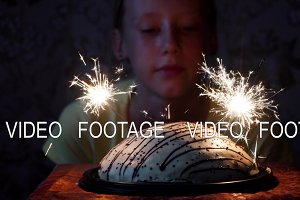 girl and cake with fireworks