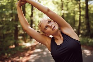 Fit young blonde woman doing stretch