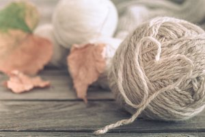 knitting threads with autumn leaves