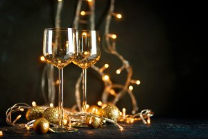 Glasses for wine and golden Christma