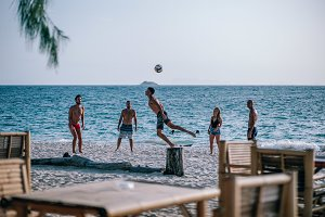 Group of Friend Playing Volleyball