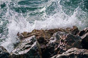 Wave Splashing Against a Rock