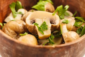Baked champignons with parsley