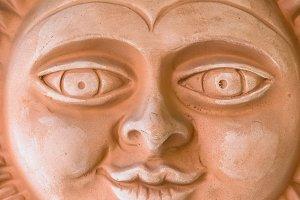 Terracotta sun face