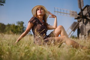 Girl and old windmill