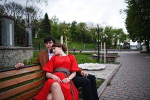 Couple lying on the bench. Stylish m