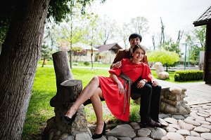 Couple sitting on bench. Stylish man