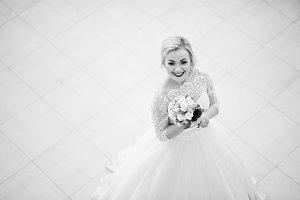 Gorgeous blonde bride posed indoor g