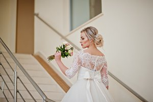 Gorgeous blonde bride posed at stair
