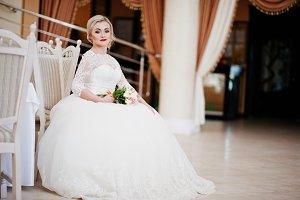 Gorgeous blonde bride with wedding b