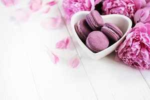 Pink peony flowers with macarons