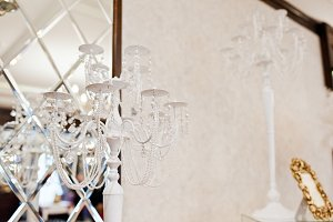 White candlestick against mirror at