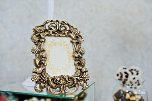 Bronze vintage frame of decor at wed