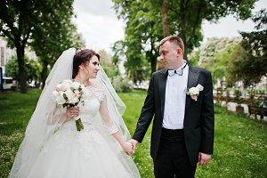 Newlyweds holding hand at their wedd