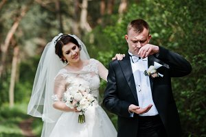 Wedding couple stay at forest. Groom