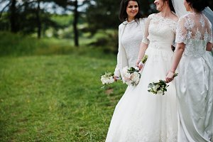 Pretty bride with bridesmaids on whi