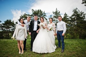Funny and happy wedding couple with