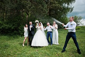 Wedding couple with their friends dr