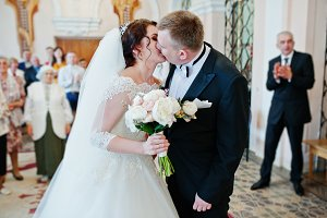Wedding couple kissed each other at