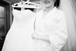 Smiling brunette bride wearing on wh