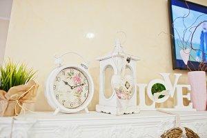 Decorative clock, candlestick and lo