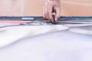 hand painting a canvas with chalk