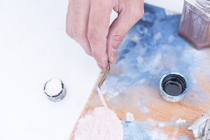 hand of a painter mixing paint