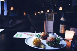 Burgers on a plate and fries