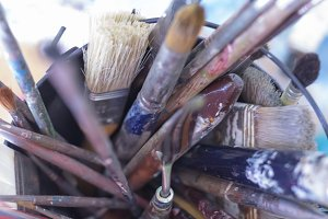paintbrushes on a container