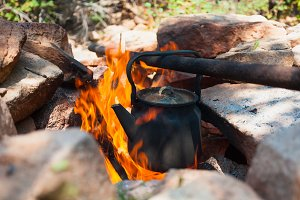 kettle is boiling on burning wood